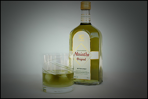burning absinthe with ice in the glass