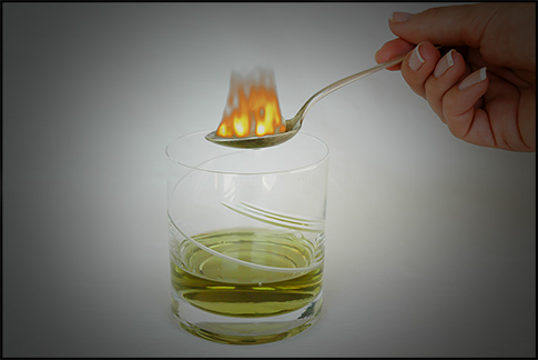 absinthe in the glass - spoon on fire